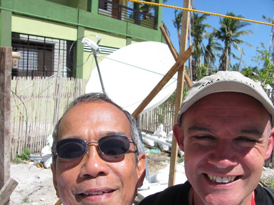 Sandy & Frank posing in front of the VSAT dish